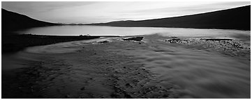 Wide stream flowing into lake at sunset. Lake Clark National Park (Panoramic black and white)