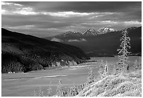 Chitina river valley, snowy peaks, and storm light. Wrangell-St Elias National Park, Alaska, USA. (black and white)