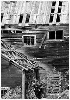 Damaged roof and walls, Kennicott mine. Wrangell-St Elias National Park, Alaska, USA. (black and white)