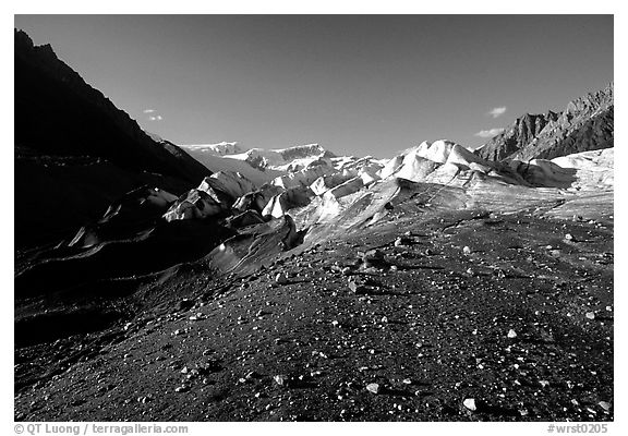 Morainic debris on Root glacier with Wrangell mountains in the background, late afternoon. Wrangell-St Elias National Park (black and white)