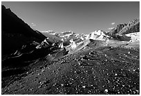 Morainic debris on Root glacier with Wrangell mountains in the background, late afternoon. Wrangell-St Elias National Park, Alaska, USA. (black and white)