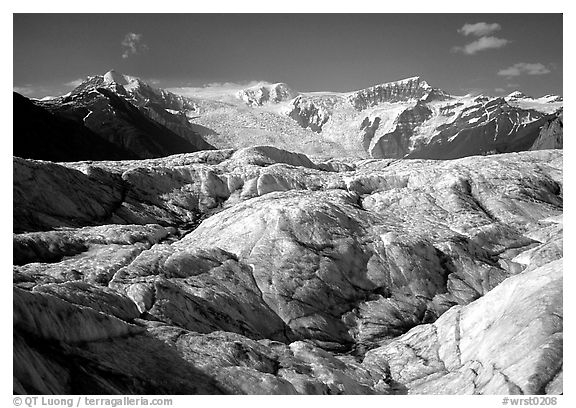 Crevasses on Root glacier, Wrangell mountains in the background. Wrangell-St Elias National Park (black and white)