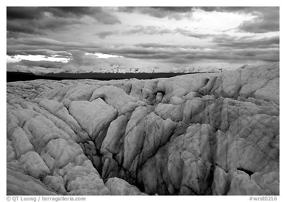 Crevasses on Root glacier at dusk, Chugach mountains in the background. Wrangell-St Elias National Park (black and white)