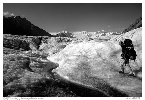 Backpacker on Root glacier. Wrangell-St Elias National Park (black and white)