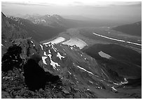 Mountaineer looking down from Mt Donoho. Wrangell-St Elias National Park ( black and white)