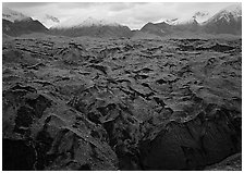 Glacier covered with black rocks. Wrangell-St Elias National Park, Alaska, USA. (black and white)