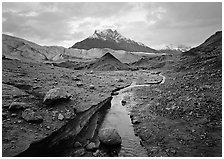 Mt Donoho above moraine, stream, and Root glacier. Wrangell-St Elias National Park ( black and white)