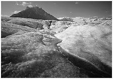 Stream running on surface of Root Glacier and Mt Donoho. Wrangell-St Elias National Park ( black and white)