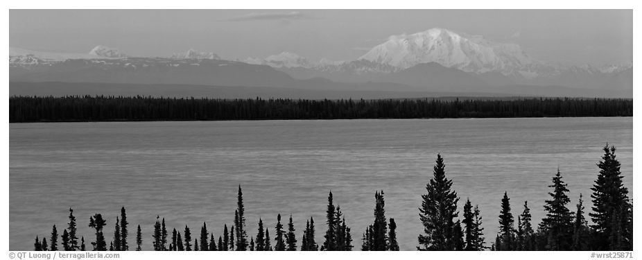 Snowy mountain rising mysteriously above lake. Wrangell-St Elias National Park (black and white)