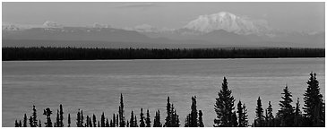 Snowy mountain rising mysteriously above lake. Wrangell-St Elias National Park (Panoramic black and white)
