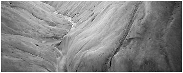 Stream and ice close-up on glacier. Wrangell-St Elias National Park (Panoramic black and white)