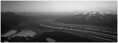 Elevated view of glacier terminal section and mountains. Wrangell-St Elias National Park (Panoramic black and white)