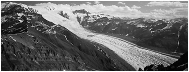 Elevated view of glacier descending from mountain. Wrangell-St Elias National Park (Panoramic black and white)