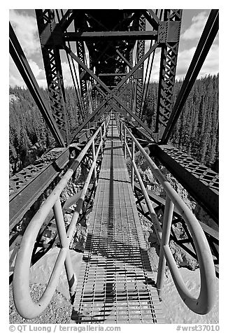 Foot catwalk below the Kuskulana river bridge. Wrangell-St Elias National Park (black and white)