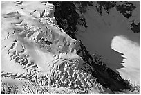 Aerial view of crevasses on steep glacier. Wrangell-St Elias National Park, Alaska, USA. (black and white)