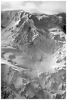Aerial view of icy face with hanging glaciers and seracs. Wrangell-St Elias National Park, Alaska, USA. (black and white)
