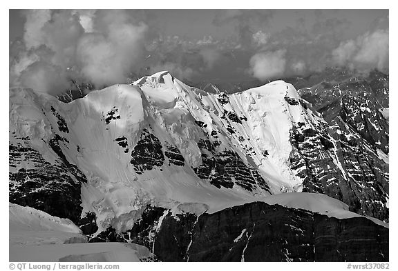 Aerial view of peak with seracs and hanging glaciers, University Range. Wrangell-St Elias National Park, Alaska, USA.