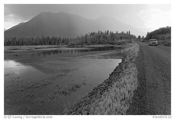 McCarthy Road and lake during afternoon storm. Wrangell-St Elias National Park (black and white)