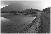 McCarthy Road and lake during afternoon storm. Wrangell-St Elias National Park, Alaska, USA. (black and white)