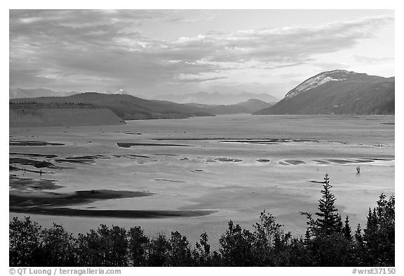 Wide Copper River at sunset. Wrangell-St Elias National Park, Alaska, USA.