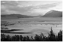 Wide Copper River at sunset. Wrangell-St Elias National Park, Alaska, USA. (black and white)