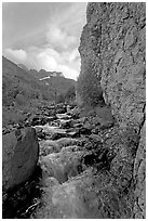Stream and cliff, Skokum Volcano. Wrangell-St Elias National Park, Alaska, USA. (black and white)