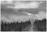 Road and Nutzotin Mountains at sunset. Wrangell-St Elias National Park, Alaska, USA. (black and white)