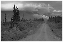 Nabena road at sunset with last light on mountains. Wrangell-St Elias National Park, Alaska, USA. (black and white)