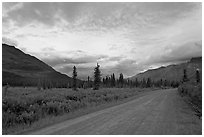 Nabena road at sunset. Wrangell-St Elias National Park, Alaska, USA. (black and white)