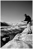 Hiker checks map on Root Glacier. Wrangell-St Elias National Park ( black and white)