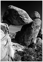Arch formed by balanced boulder, Grapevine mountains. Big Bend National Park, Texas, USA. (black and white)