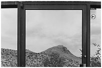 Santiago mountains, Persimmon Gap Visitor Center window reflexion. Big Bend National Park, Texas, USA. (black and white)