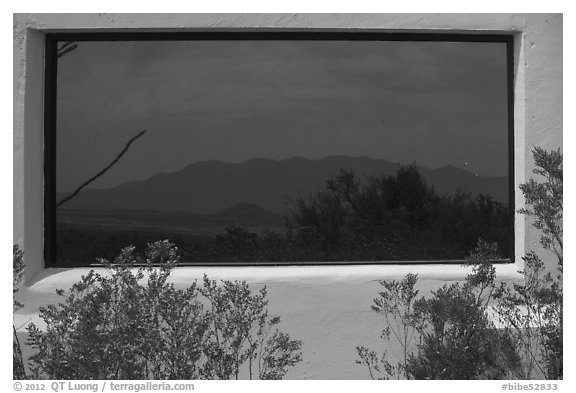 Chisos mountains, Persimmon Gap visitor center window reflexion. Big Bend National Park (black and white)