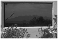 Chisos mountains, Persimmon Gap visitor center window reflexion. Big Bend National Park, Texas, USA. (black and white)
