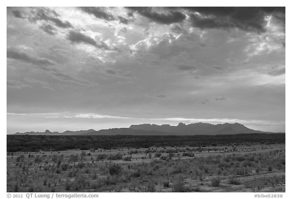 Dry riverbed, distant Chisos Mountains, and clouds. Big Bend National Park (black and white)