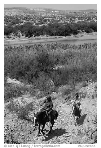 Mexican horsemen from Boquillas Village. Big Bend National Park (black and white)