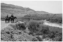 Horsemen and Rio Grande River. Big Bend National Park, Texas, USA. (black and white)