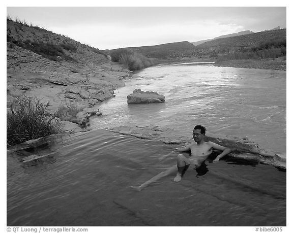 Visitor relaxes in hot springs next to Rio Grande. Big Bend National Park (black and white)