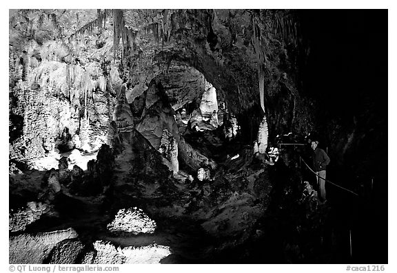 Visitor in large room. Carlsbad Caverns National Park (black and white)
