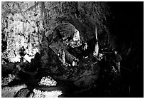 Visitor in large room. Carlsbad Caverns National Park, New Mexico, USA. (black and white)