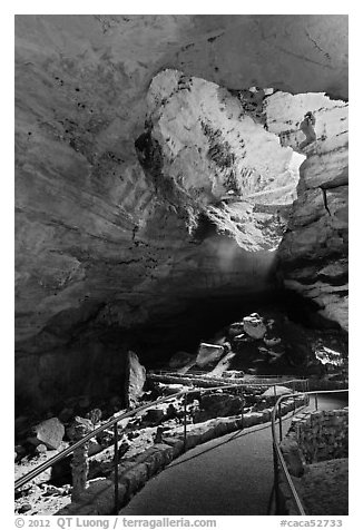 Walkway inside cave and natural entrance. Carlsbad Caverns National Park (black and white)