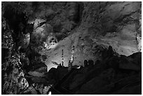 Park visitor looking,  room above Whales Mouth. Carlsbad Caverns National Park, New Mexico, USA. (black and white)