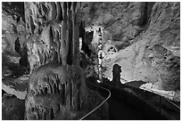 Path passing next to huge stalagmite. Carlsbad Caverns National Park, New Mexico, USA. (black and white)