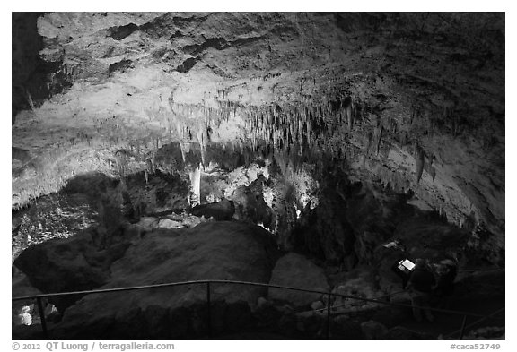 Tourists looking at Green Lake room from above. Carlsbad Caverns National Park (black and white)