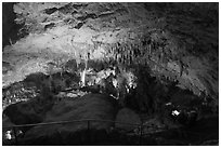 Tourists looking at Green Lake room from above. Carlsbad Caverns National Park ( black and white)