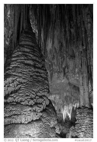 Stalagmite and flowstone framing chandelier. Carlsbad Caverns National Park (black and white)