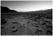 Evaporation patterns on salt flats near Badwater, dusk. Death Valley National Park, California, USA. (black and white)