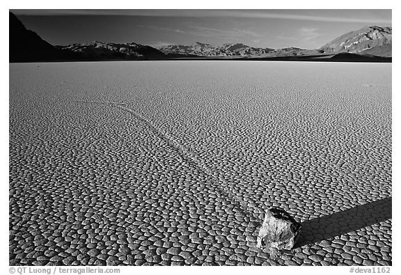 Tracks, moving rock on the Racetrack, late afternoon. Death Valley National Park, California, USA.