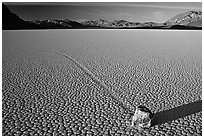 Tracks, moving rock on the Racetrack, late afternoon. Death Valley National Park ( black and white)