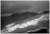 Storm light on foothills. Death Valley National Park, California, USA. (black and white)